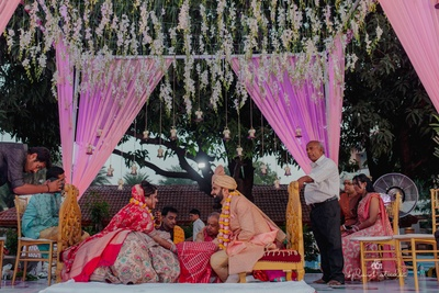 Couple striking a much-in-love pose during their wedding ceremony