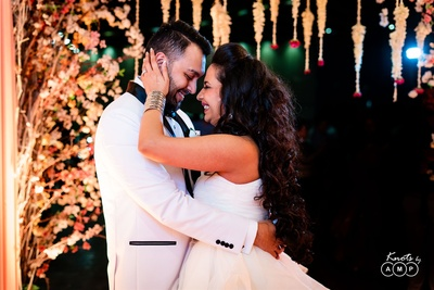 the bride and groom posing romantically at their reception