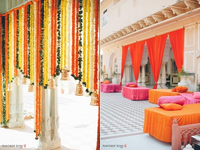 Wedding venue decorated with Marigold string ends with bell ends and fuchsia and orange drapes
