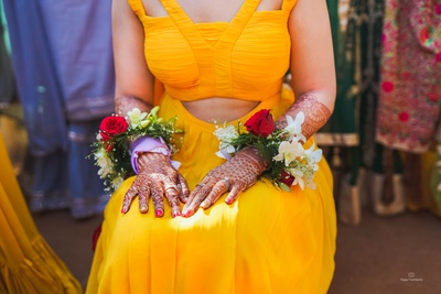 The gorgeous bride flaunts her floral bracelets!