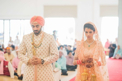 The wedding rituals taking place at the gurudwara
