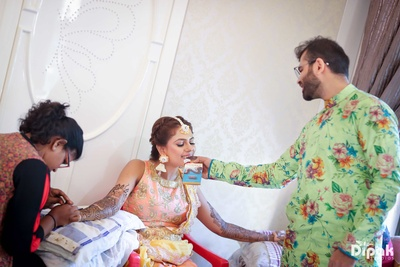 Candid moment captured between the bride and groom during the mehndi function