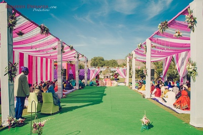 Pink and white drape decor for the sikh wedding ceremony.