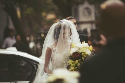 The blushing bride behind her veil