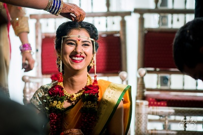 Candid wedding photography of the bride at the mandap