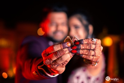 brilliant picture of the couple with their engagement rings