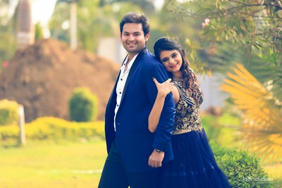 Groom's navy blue suit perfectly matches the bride's blue ball gown