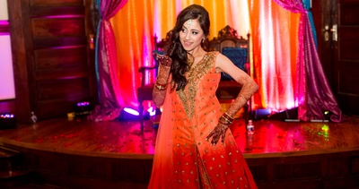 The bride grooving while flaunting a beautiful, shimmery orange suit!
