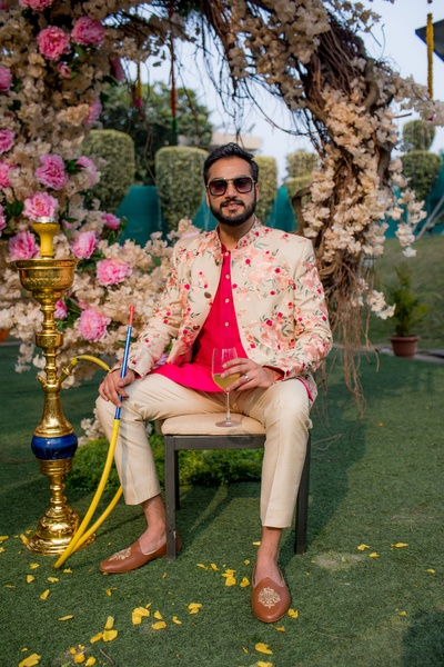 The groom chilling at his mehendi ceremony, while smoking hookah!