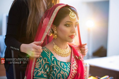 Bride-to-be! Dressed in traditional hues, and metallic make-up highlighting exuberant gold jewelery