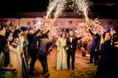Bride and groom enter together at their reception party at Della Resorts, Lonavala