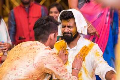 Brother of the bride smearing haldi on his jiju
