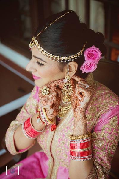 Adorned in beautiful kundan bridal jewellery.