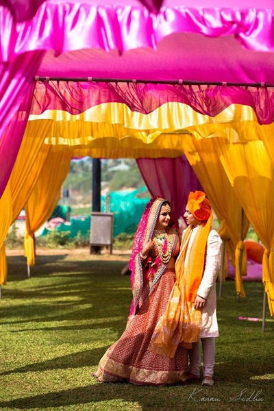 Bride and groom dressed in complementing outfits for the wedding at Vivanta By Taj, Goa
