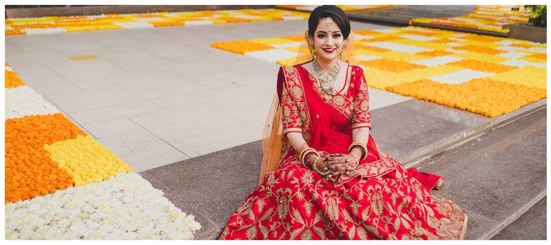 Siddharth & Aastha Ahmedabad : A classic Gujarati wedding with the bride wearing a beautiful red lehenga designed by herself.
