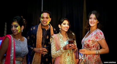 bride and groom with friends at the sangeet ceremony