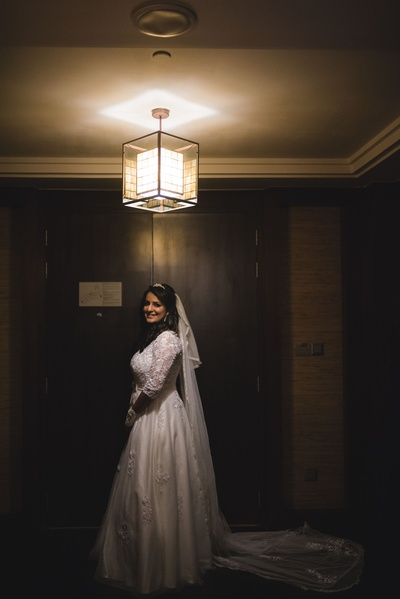 Dressed up in a pure white wedding gown for the Christian Wedding.
