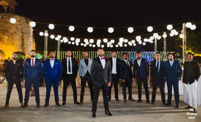 The groom is ready with his tribe- all suited up!