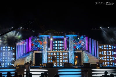 Cutwork, artistic patterns, pillars and chequered designs for stage decoration