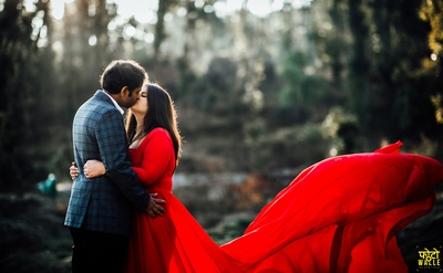 The adorable and super-romantic couple steal a kiss at their pre-wedding shoot!