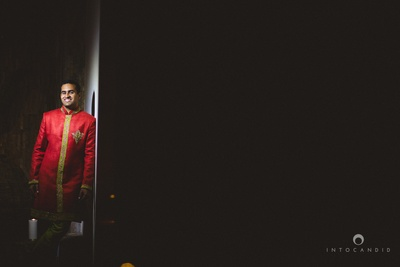 Rahul decked up in an orangish red band gala for the sangeet ceremony.
