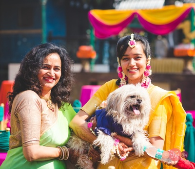 Ritika with her mother and her cute lil doggo.