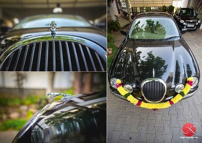 Black metallic Jaguar decorated with a Marigold garland