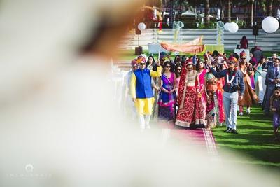 Bridal entry under the phoolon ki chaadar.