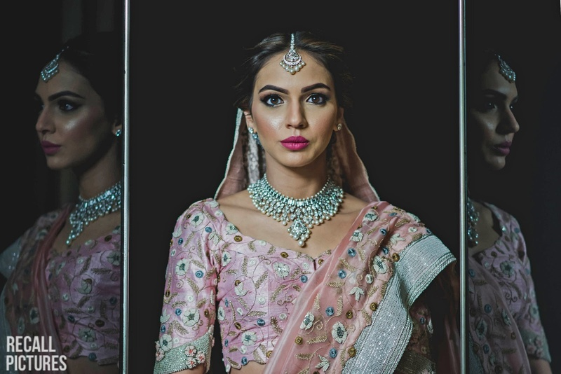 7. Pastel pink lehenga paired with minimalistic silver jewellery (something we will definitely copy from this bride!)