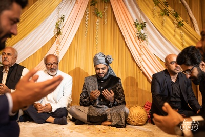 For the Nikah, Sarmad  a black sherwani and grey churidars and accessorised with a matching black pashmina embroidered with intricate Kalamkaari work (threadwork as intricate and finely done as lines made with a pen on paper.