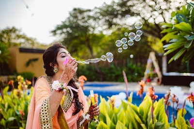 A cute picture of the bride at her mehendi