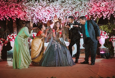 the newly wed bride posing with her family at the reception