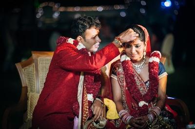 Red and blue wedding lehenga styled with minimal polki studded jewellery