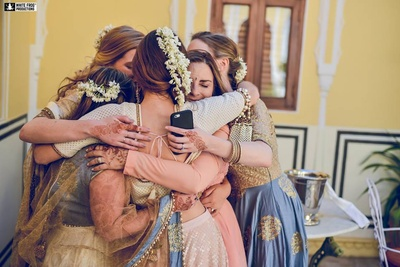 Bridesmaids hugging each other!