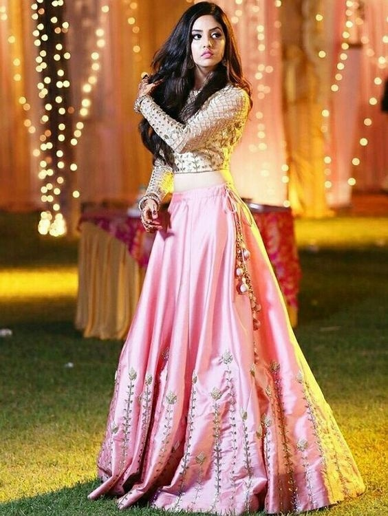 c334d0b62fa A simple lehenga design like this one is ideal to wear on your cocktail  night or sangeet. The simple satin lehenga with minimal detailing  complements ...