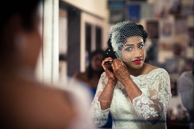 Bride Ujwala wearing white lacy bridal wedding gown by Elle Studio.