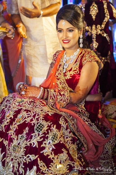 Maroon bridal lehenga featuring floral patchwork and chequered design