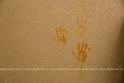 Imprints of the bride's palms symbolizing wealth and prosperity