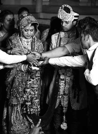 Bride adorning dense kaliras on her wrists along with her choodas