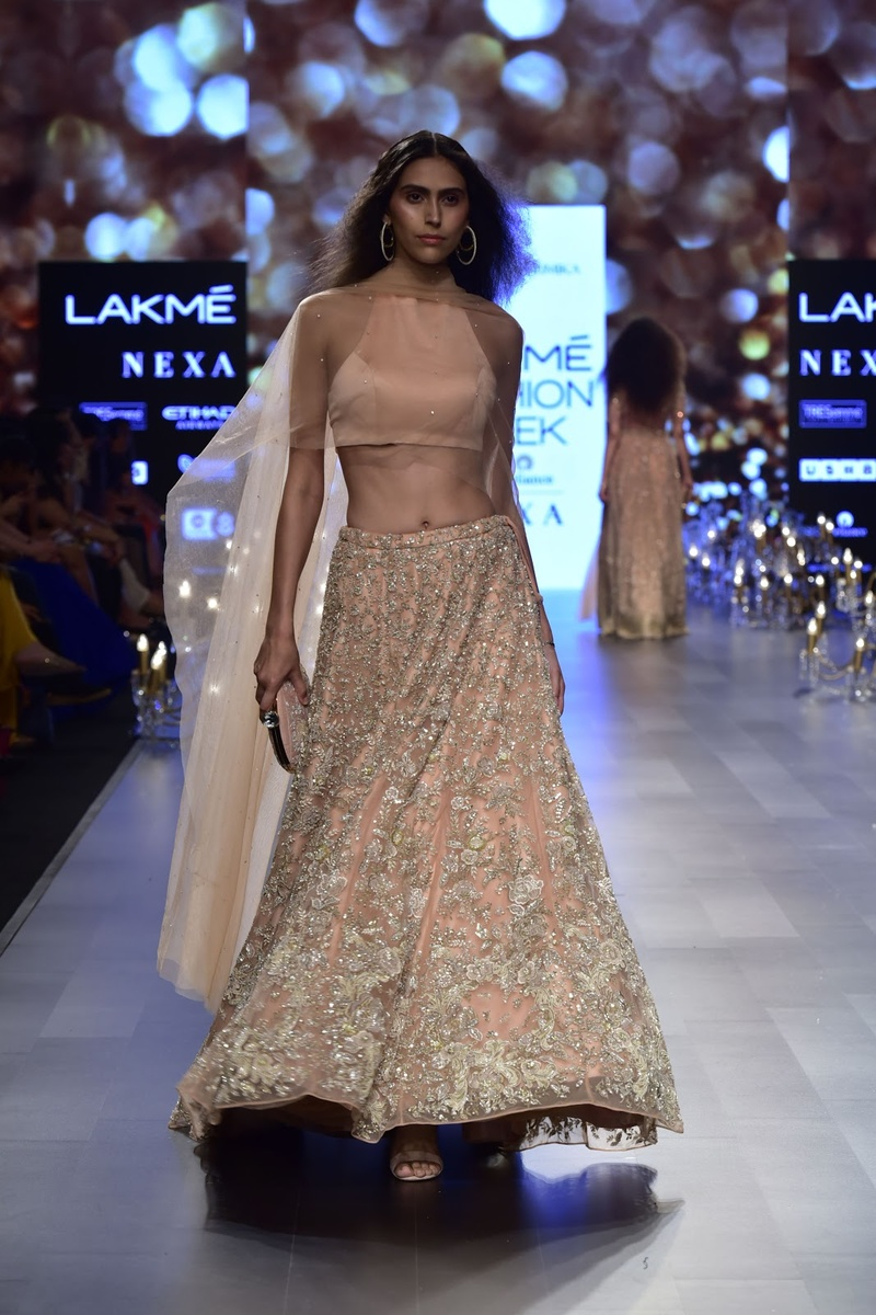 3. This baby peach lehenga with intricate zari work is too pretty to ignore!