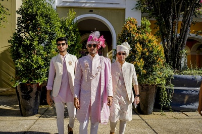 the groom and his groomsmen in full swag
