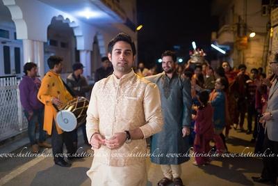 Cream silk Kurta styled with a matching damask patterned jacket