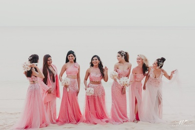 the bridesmaids in coral gowns for the wedding