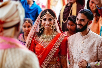 Bride and groom see each other for the first time at the wedding mandap
