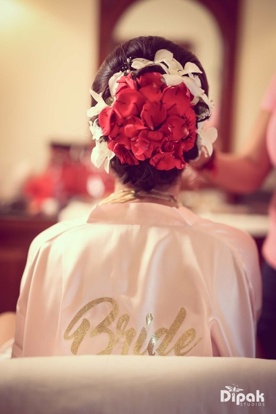 The bride's floral hair bun