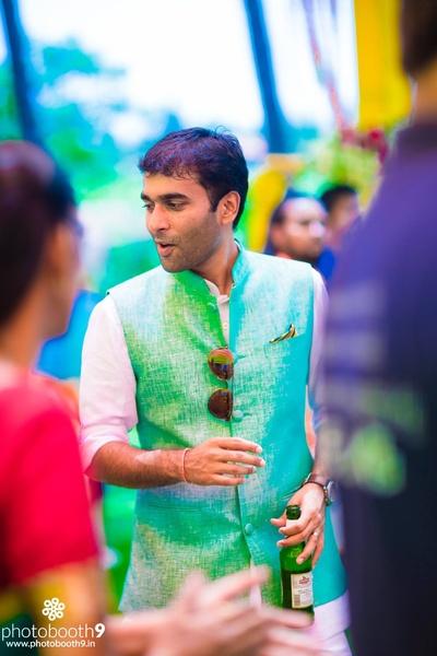Aqua nehru jacket styled with white churidaar kurta