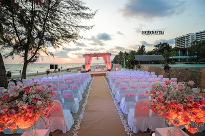 the mandap decorated in hues of coral, white and pink
