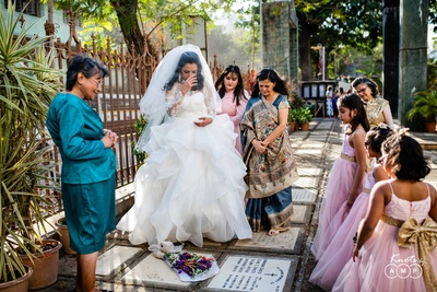 the bride and her family paying respects to a loved one