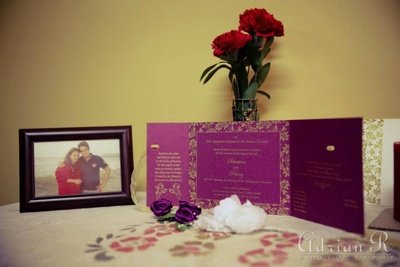 An elegant purple and gold wedding invitation