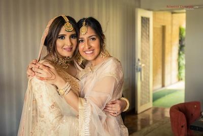 Bride and her bridesmaid candid shot before the wedding function at Della Resorts, Lonavala